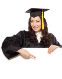 Grad pointing at copy space Stock Photography
