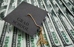 Grad school money Stock Photography