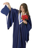 Grad Student. Female student wearing grad gown with reluctant facial expression Stock Photo