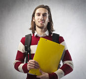 Grad student. Smiling young student holding a notebook Royalty Free Stock Photos