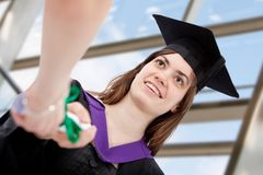 Grad student getting her diploma Royalty Free Stock Image