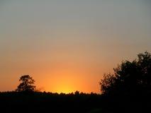 Gradacja szarość i pomarańcze zmierzchu afterglow Fotografia Royalty Free