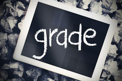 Grade against tablet pc with blue screen Royalty Free Stock Image
