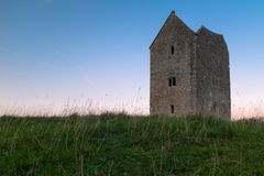 The grade II listed Dovecote Tower at Bruton in Somerset shot at sunset