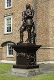 A Grade II listed statue of Oliver Cromwell  on a plinth in the. Grounds of the Warrington Academy Building Warrington Cheshire May 2018 Stock Photos