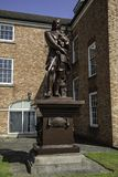 A Grade II listed statue of Oliver Cromwell  on a plinth in the. Grounds of the Warrington Academy Building Warrington Cheshire May 2018 Royalty Free Stock Photo