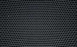 A grade metálica redonda distorcida de Grey Macro fura a textura da colmeia Imagem de Stock Royalty Free