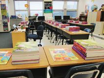 Grade school. Empty classroom with books, desks and chairs Stock Photo