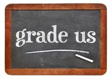 Grade us - feedback request. White chalk text on a vintage slate blackboard stock photos