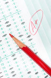 Graded test form. A graded test form with red scoring pencil indicates acheivement and success in education stock image