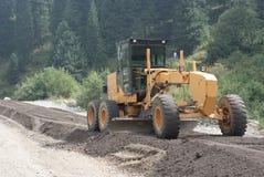 Grader. Constructing a new road Stock Image