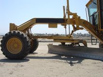 Grader Blade. Grader on Construction Site Royalty Free Stock Photo