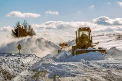 Grader cleaning road in winter Royalty Free Stock Photography