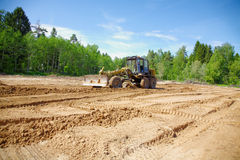 The grader clears away a ground Stock Images