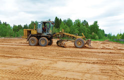 The grader clears away a ground Royalty Free Stock Image