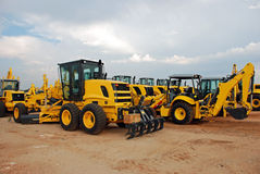 Grader and Excavator Construction Equipment Yard Royalty Free Stock Photography