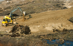 Grader and excavator leveled surface Stock Images