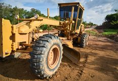 Grader. Clearing a construction site Royalty Free Stock Image