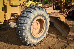 Grader. Clearing a construction working outside Royalty Free Stock Image