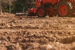 Grader leveling landfill on construction site before kick off pr. Oject stock image