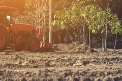Grader leveling landfill on construction site before kick off pr. Oject stock images