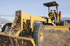 Grader and Operator Royalty Free Stock Images