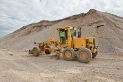Grader for road construction in a gravel pit Royalty Free Stock Photography