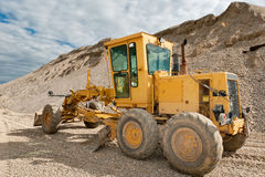 Grader for road construction in a gravel pit Royalty Free Stock Photos