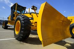 Grader with scoop Stock Photo