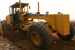 Grader scraping Stock Image