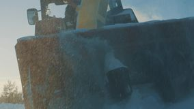 Grader and of tractor removing snow from the road stock video footage
