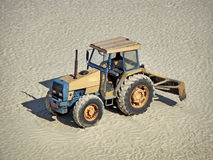 Grader truck parked on sand Stock Image