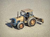 Grader truck parked on sand Stock Image