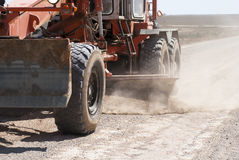Grader in work. The grader repairs the gravel road Stock Photo