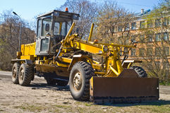 Grader working. Grader building a new road in the city royalty free stock photography