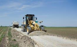 Grader working on gravel leveling Stock Photo