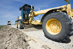 Grader working on gravel leveling Stock Photography