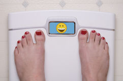 Gradera med fot lyckliga Emoji Royaltyfria Bilder