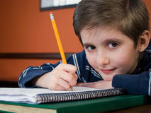 Gradeschool kid doing homework Royalty Free Stock Images