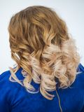 Gradient color on womens curly hair. Close up. stock photos