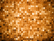 Gradient goldcolored mosaic tiles. Gradient gold colored mosaic background tiles Royalty Free Stock Photos