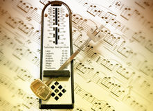 Gradient metronome. Metronome on music scores - gradient overlay - Other color settings available Royalty Free Stock Photography