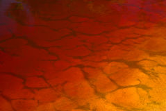 Gradient orange water background. Water of the cola creek in Suriname. Abstract gradient background of yellow and red Stock Photo