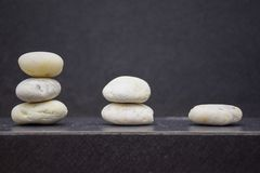 Gradient stones on table with free space and blur background stock images