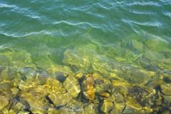 Gradient transition from the sea to the stone bank Stock Photography