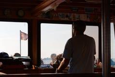 At the Helm Toward Barbana Island royalty free stock image