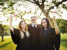 Grads at graduation ceremony Stock Photography