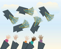Grads Throwing Caps Royalty Free Stock Photo