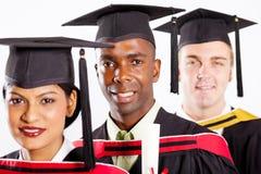 Graduación de los estudiantes universitarios Imagen de archivo libre de regalías