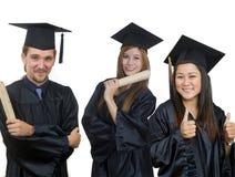 Graduación de tres estudiantes Fotos de archivo